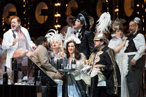opening scene, l-r: Aled Hall (Viscount Gaston), Lukhanyo Moyake (Alfredo Germont), Heather Shipp (Flora Bervoix - blowing kiss), Claudia Boyle (Violetta Valery), Bozidar Smiljanic (Marquis D'Obigny -...