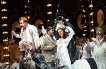 opening scene, from left: Aled Hall (Viscount Gaston), Lukhanyo Moyake (Alfredo Germont), Claudia Boyle (Violetta Valery) in the new production of LA TRAVIATA by Verdi opening at English National Oper...