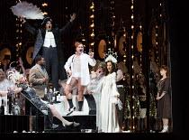 opening scene, l-r: Heather Shipp (Flora Bervoix - reclining), Lukhanyo Moyake (Alfredo Germont), (standing, rear) Bozidar Smiljanic (Marquis D'Obigny), Aled Hall (Viscount Gaston), Claudia Boyle (Vio...