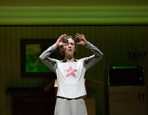 examining button eyes: Mary Bevan (Coraline) in the world premiere of CORALINE opening at the Barbican Theatre, London EC2 on 29/03/2018  a Royal Opera production music: Mark-Anthony Turnage libretto...
