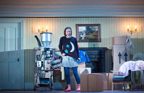 Mary Bevan (Coraline) with her father's waste disposal invention in the world premiere of CORALINE opening at the Barbican Theatre, London EC2 on 29/03/2018  a Royal Opera production music: Mark-Anth...