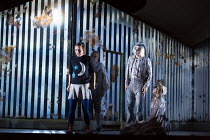through the mirror - l-r: Mary Bevan (Coraline), Harry Nicoll (Ghost Child 2), Dominic Sedgwick (Ghost Child 3), Gillian Keith (Ghost Child 1) in the world premiere of CORALINE opening at the Barbican...