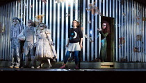through the mirror - l-r: Dominic Sedgwick (Ghost Child 3), Harry Nicoll (Ghost Child 2), Gillian Keith (Ghost Child 1), Mary Bevan (Coraline), Kitty Whateley (Other Mother) in the world premiere of C...