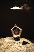 HAPPY DAYS by Samuel Beckett design: Jocelyn Herbert lighting: Jack Raby director: Samuel Beckett  Billie Whitelaw (Winnie) Royal Court Theatre, London SW1 07/06/1979 (c) Donald Cooper/Photostage ph...