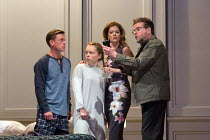 l-r: Samuel Boden (Boy, later Young King), Ocean Barrington-Cook (Girl), Barbara Hannigan (Isabel), Peter Hoare (Mortimer) in LESSONS IN LOVE AND VIOLENCE by George Benjamin and Martin Crimp opening a...