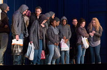 destitute migrants with (far right) Jennifer France (Witness 1), Krisztina Szabo (Witness 2) in LESSONS IN LOVE AND VIOLENCE by George Benjamin and Martin Crimp opening at The Royal Opera, Covent Gard...