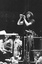 Andre Previn (born Germany 1929, American conductor & composer) rehearsing the London Symphony Orchestra (LSO) ~BBC Prom, William Walton programme, Royal Albert Hall, London 09/1972~(c) Donald Cooper/...
