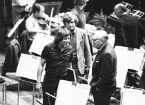 Andre Previn (conductor) talking to Sir William Walton (composer) after a rehearsal with the London Symphony Orchestra (LSO) ~BBC Prom, William Walton programme, Royal Albert Hall, London 09/1972(c) D...