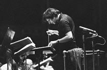 Andre Previn (born Germany 1929, American conductor & composer) studying his score ~London Symphony Orchestra (LSO) BBC Prom, William Walton programme, Royal Albert Hall, London 09/1972(c) Donald Coop...