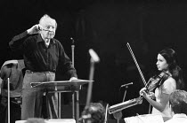 Leopold Stokowski (English conductor - 1882-1977) rehearsing the London Symphony Orchestra (LSO) for his 60th anniversary concert with Silvia Marcovici (violin) ~Royal Festival Hall, London 06/1972~(c...