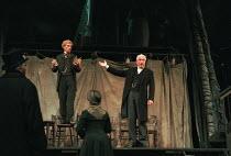 AN ENEMY OF THE PEOPLE by Henrik Ibsen in a version by Christopher Hampton set design: John Napier costumes: John Bright lighting: David Hersey director: Trevor Nunn   on platform, l-r: Ian McKellen...