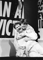 THE NORMAL HEART by Larry Kramer design: Geoff Rose lighting: Gerry Jenkinson director: David Hayman  l-r: Paul Jesson (Felix Turner), Tom Hulce (Ned Weeks) Royal Court Theatre production / transferr...