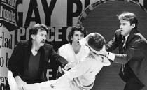 THE NORMAL HEART by Larry Kramer design: Geoff Rose lighting: Gerry Jenkinson director: David Hayman  l-r: Martin Sheen (Ned Weeks), Joris Stuyck (Mickey Marcus) (being supported) Kerry Shale (Craig...