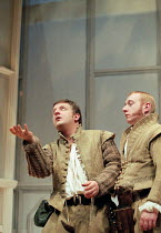 ROSENCRANTZ AND GUILDENSTERN ARE DEAD by Tom Stoppard design: Lez Brotherston lighting: Howard Harrison director: Matthew Francis <br> tossing a coin - l-r: Simon Russell Beale (Guildenstern), Adrian...
