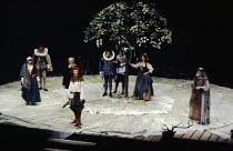 AS YOU LIKE IT by Shakespeare set design: Hayden Griffin costumes: Peter J Hall lighting: Andy Phillips fights: William Hobbs director: John Dexter <br> in the Forest of Arden - front left: Selina Cad...