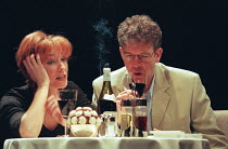 CELEBRATION by Harold Pinter set design: Eileen Diss costumes: Dany Everett lighting: Mick Hughes director: Harold Pinter <br>Lia Williams (Suki), Steven Pacey (Russell)Almeida Theatre, London N1 22/0...