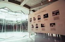 Saitama Arts Theater, Tokyo, Japan 09/1999 <br> interior, foyer with portraits and biographies of Royal Shakespeare Company (RSC) directors Peter Hall, John Barton, Trevor Nunn, Terry Hands, Peter Br...