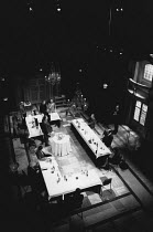 THE SHAPE OF THE TABLE by David Edgar design: Dermot Hayes lighting: Paul Pyant direcor: Jenny Killick <br>conference meeting viewed from aboveCottesloe Theatre, National Theatre (NT), London SE1 08/1...