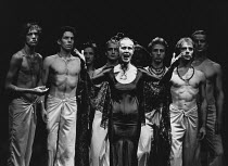 AGAMEMNON by Aeschylus adapted and directed by Steven Berkoff lighting: John Gorringe <br> centre: Deborah Norton (Clytemnestra) with male Chorus (far left: Hilton McRae) London Theatre Group / Greenw...