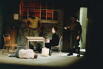 MOUNTAIN LANGUAGE written & directed by by Harold Pinter design: Michael Taylor lighting: Laurence Clayton <br>l-r: (on stage, beaten) Tony Haygarth (Prisoner), (rear) George Harris (Guard), Eileen At...