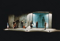 MOUNTAIN LANGUAGE written & directed by by Harold Pinter design: Michael Taylor lighting: Laurence Clayton <br> opening scene, cente - with blue scarf: Miranda Richardson (Young Woman) with shopping b...