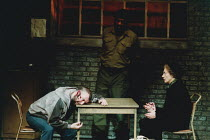 MOUNTAIN LANGUAGE written & directed by by Harold Pinter design: Michael Taylor lighting: Laurence Clayton <br>l-r: Tony Haygarth (Prisoner), George Harris (Guard), Eileen Atkins (Elderly Woman)Lyttel...