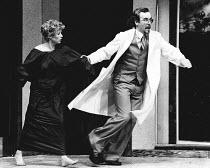 WHAT THE BUTLER SAW by Joe Orton design: Marty Flood lighting: Chic Reid director: Michael Attenborough <br> Tina Jones (Geraldine Barclay), John Darrell (Dr. Prentice) Young Vic Theatre, London SE1...