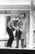 LOOT by Joe Orton design: Saul Radomsky lighting: Mick Hughes director: Jonathan Lynn <br> l-r: Neil Pearson (Hal), Leonard Rossiter (Truscott) Ambassador's Theatre, London WC2 13/03/1984 (c) Donald...