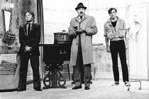 LOOT by Joe Orton design: Saul Radomsky lighting: Mick Hughes director: Jonathan Lynn <br>l-r: David John (Dennis), Leonard Rossiter (Truscott), Neil Pearson (Hal)Lyric Theatre, London W1 19/09/1984 (...