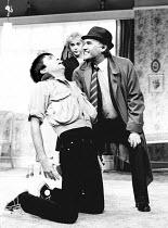 LOOT by Joe Orton design: Saul Radomsky lighting: Mick Hughes director: Jonathan Lynn <br> l-r: Neil Pearson (Hal), Gemma Craven (Fay), Dinsdale Landen (Truscott) Lyric Theatre, London W1 10/1984 (c)...
