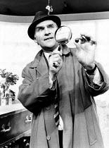 LOOT by Joe Orton design: Saul Radomsky lighting: Mick Hughes director: Jonathan Lynn <br> Dinsdale Landen (Truscott) Lyric Theatre, London W1 10/1984 (c) Donald Cooper/Photostage photos@photostage.co...