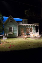 ALL MY SONS by Arthur Miller design: Max Jones lighting: Richard Howell director: Jeremy Herrin <br> stage, set, exterior, house, garden, yard, porch, chairs, trees, sky The Old Vic, London SE1 23/04/...