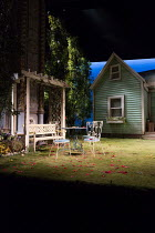 ALL MY SONS by Arthur Miller design: Max Jones lighting: Richard Howell director: Jeremy Herrin <br> stage, set, exterior, house, garden, yard, porch, gazebo, chairs, trees, sky The Old Vic, London SE...