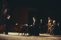 THE WINSLOW BOY by Terence Rattigan design: Mark Bailey lighting: Ben Ornerod director: Wyn Jones <br> left: William Mannering (Ronnie Winslow) centre:Simon Williams (Sir Robert Morton) seated right:...