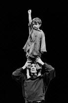 CORIOLANUS by Shakespeare design & lighting: John Bury fights: Malcolm Ranson music: Harrison Birtwistle director: Peter Hall <br> Ian McKellen (Coriolanus) with Young Martius Olivier Theatre, Nationa...