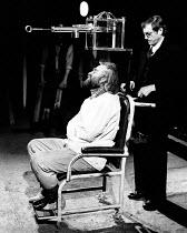 LEAR by Edward Bond after Shakespeare's 'King Lear' design: Kit Surrey lighting: Leo Leibovici fights: Malcolm Ranson director: Barry Kyle <br> l-r: Bob Peck (Lear), David Bradley (Prison Doctor) Roya...