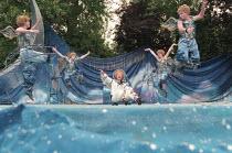 A MIDSUMMER NIGHT'S DREAM by Shakespeare design: James Merifield lighting: Jason Taylor director: John Doyle <br>~centre: Toyah Willcox (Puck) with fairies Open Air Theatre, Regent's Park, London 14/0...