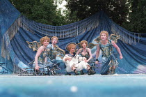 A MIDSUMMER NIGHT'S DREAM by Shakespeare design: James Merifield lighting: Jason Taylor director: John Doyle <br> centre: Toyah Willcox (Puck) with fairies Open Air Theatre, Regent's Park, London 14/...