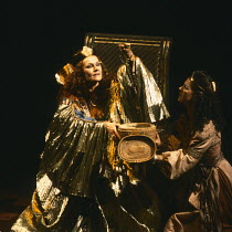 ANTONY AND CLEOPATRA by Shakespeare set design: Alison Chitty lighting: Stephen Wentworth director: Peter Hall <br>~l-r: Judi Dench (Cleopatra - holding the asp), Miranda Foster (Charmian)~Olivier The...