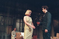THE HOMECOMING by Harold Pinter design: William Dudley lighting: Hugh Vanstone director: Roger Michell <br> Lindsay Duncan (Ruth), Michael Sheen (Lenny) with (rear left) Keith Allen (Teddy) Lyttelton...