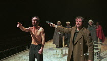 THE ENDS OF THE EARTH by David Lan design: Richard Hudson lighting: Simon Corder choreographer: Kate Flatt director: Andrei Serban <br> front, l-r: Declan Conlon (Takic), Tom Mannion (Pintilje) Cottes...