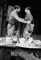 JOURNEY'S END by R. C. Sherriff design: Alan Pickford lighting: Michael O'Flaherty director: Eric Thompson <br> l-r: Peter Egan (Captain Stanhope), Bruce Robinson (2nd Lieutenant Hibbert) Mermaid Thea...