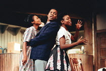 A RAISIN IN THE SUN by Lorraine Hansberry design: Martin Johns lighting: Leonard Tucker director: Lou Stein <br> l-r: Valerie Buchanan (Ruth Younger), Don Warrington (Walter Lee Younger), Marcia Myrie...