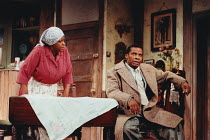 A RAISIN IN THE SUN by Lorraine Hansberry design: Martin Johns lighting: Leonard Tucker director: Lou Stein <br> Isabelle Lucas (Lena Younger / Mama), Don Warrington (Walter Lee Younger) Palace Theatr...