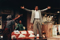 A RAISIN IN THE SUN by Lorraine Hansberry design: Martin Johns lighting: Leonard Tucker director: Lou Stein <br> l-r: Valerie Buchanan (Ruth Younger), Marcia Myrie (Beneatha Younger), Don Warrington (...