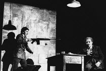 THE VISIT by Friedrich Durrenmatt adapted by Maurice Valency design: Rae Smith lighting: Luke Sapsed directors: Annabel Arden & Simon McBurney <br> l-r: Marcello Magni (Inspector Schultz), Simon McBur...