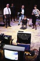 H.I.D. (Hess is Dead) by Howard Brenton design: Eryl Ellis & Kenny MacLellan lighting: Geraint Pughe director: Danny Boyle <br> l-r: David Calder (Larry Palmer), Mark Strong (Officer), Pip Donaghy (Ra...