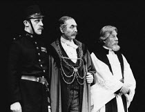 SERJEANT MUSGRAVE'S DANCE by John Arden set design: Peter Hartwell costumes: Pamela Howard director: John Burgess <br> l-r: David Troughton (The Constable), Leonard Fenton (The Mayor), Michael Gough (...