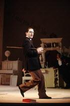 TRAVESTIES by Tom Stoppard design: Richard Hudson lighting: Jennifer Tipton movement: Sue Lefton director: Adrian Noble <br> Lloyd Hutchinson (James Joyce) Royal Shakespeare Company (RSC), Barbican Th...