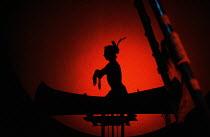 HIAWATHA by Henry Longfellow design: Marty Flood lighting: Chris Ellis director: Michael Bogdanov <br> Native American in canoe Olivier Theatre, National Theatre (NT), London SE1 10/12/1980 (c) Donald...